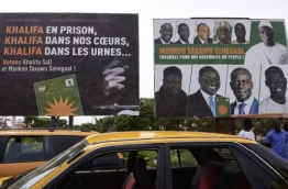 This picture taken on July 29, 2017, in Dakar, shows electoral posters on the eve of legislatives elections. / AFP PHOTO / SEYLLOU