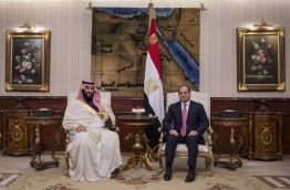 """A handout picture released by the Saudi Royal Palace shows Egyptian President Abdel Fattah al-Sisi (R) meeting with Saudi Arabia's Crown Prince Mohammed bin Salman upon his arrival in Cairo on March 4, 2018. / AFP PHOTO / HO / RESTRICTED TO EDITORIAL USE - MANDATORY CREDIT """"AFP PHOTO / SAUDI ROYAL PALACE"""" - NO MARKETING NO ADVERTISING CAMPAIGNS - DISTRIBUTED AS A SERVICE TO CLIENTS"""