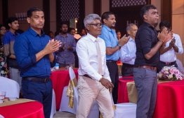 """Paradise Island Resort, May 5, 2018: Ahmed """"Bodu Heena"""" Saleem heads to the stage to receive the Lifetime Achievement """"Mohamed Zahir Naseer Award"""", for his longstanding contributions to the fields of football, badminton and athletics. PHOTO/IMAGES.MV"""