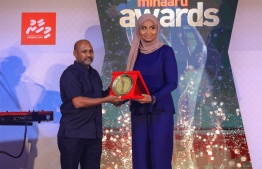 Paradise Island Resort, May 5, 2018: Swimmer Mubaal Azzam Ibrahim was awarded Most Promising Individual Sports Player in the men's category. The award was presented by the former top female basketball player of the Maldives, Aminath Shiura (R), and it was received on Mubaal's behalf by his father. PHOTO/IMAGES.MV