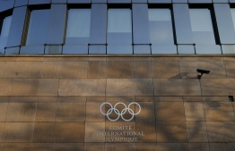 A picture taken in Lausanne, on February 15, 2019 shows the olympics logo on the IOC Headquarters building. (Photo by SALVATORE DI NOLFI / POOL / AFP)