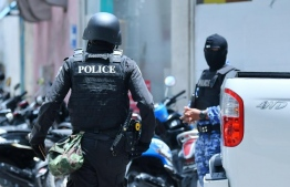 Police officers during the special operation conducted as part of the Commission on Investigation of Murders and Enforced Disappearances' probe into the case of missing journalist Ahmed Rilwan, in September 2019. PHOTO: HUSSAIN WAHEED / MIHAARU