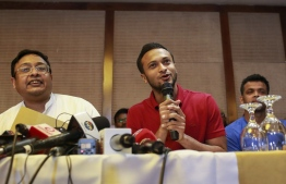 """Bangladesh national cricket team captain Shakib Al Hasan (C) speaks with journalist in Dhaka on October 23, 2019. - The boycotting Bangladeshi players made new demands on October 23, including a share of the board's revenue as a crisis surrounding cricket in the country deepened. Supreme Court lawyer Mustafizur Rahman Khan read out a list of 13 demands on behalf of the Bangladeshi cricketers at a news conference, which also included a """"feasible"""" wage for female players. (Photo by STR / AFP)"""