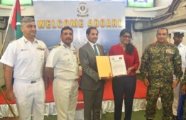 Minister of Defence Mariya Ahmed Didi formally accepting the donation of ammunition from Indian Ambassador to Maldives Sunjay Sudhir. PHOTO: MINISTRY OF DEFENCE