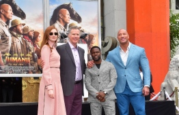 Comedian Kevin Hart poses with Will Ferrell and from the Jumanji cast, Dwayne Johnson and Karen Gillan at his Hand and Footprints ceremony in Hollywood, California on December 10, 2019. (Photo by Frederic J. BROWN / AFP)