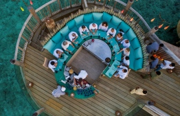 Overhead view of diners enjoying a meal at the restaurant 'So Bespoke' at Soneva Fushi. PHOTO/SONEVA