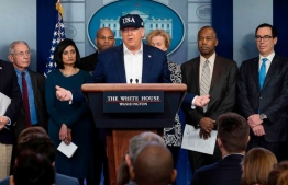 President Donald Trump gives a press briefing about the coronavirus (COVID-19) alongside members of the Coronavirus Task Force in the Brady Press Briefing Room at the White House, in Washington, March 14, 2020. PHOTO: GETTY IMAGES