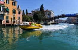 An ambulance speedboat sails a canal in Venice on March 18, 2020, during the country's lockdown within the new coronavirus crisis. (Photo by ANDREA PATTARO / AFP)